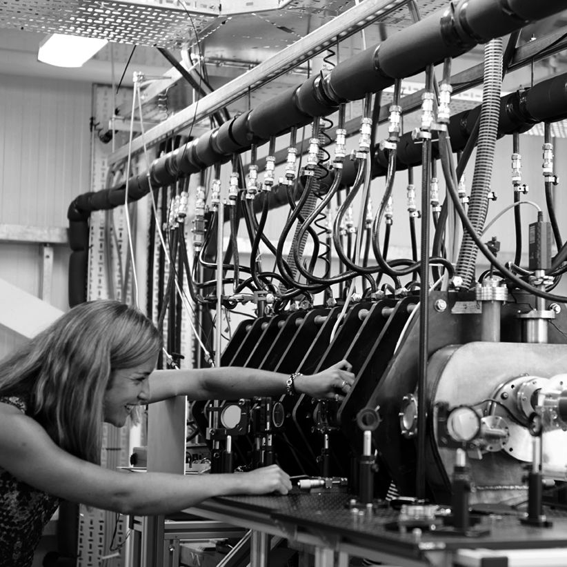 a woman working with machinery