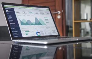 image of laptop displaying graphs and data analytics