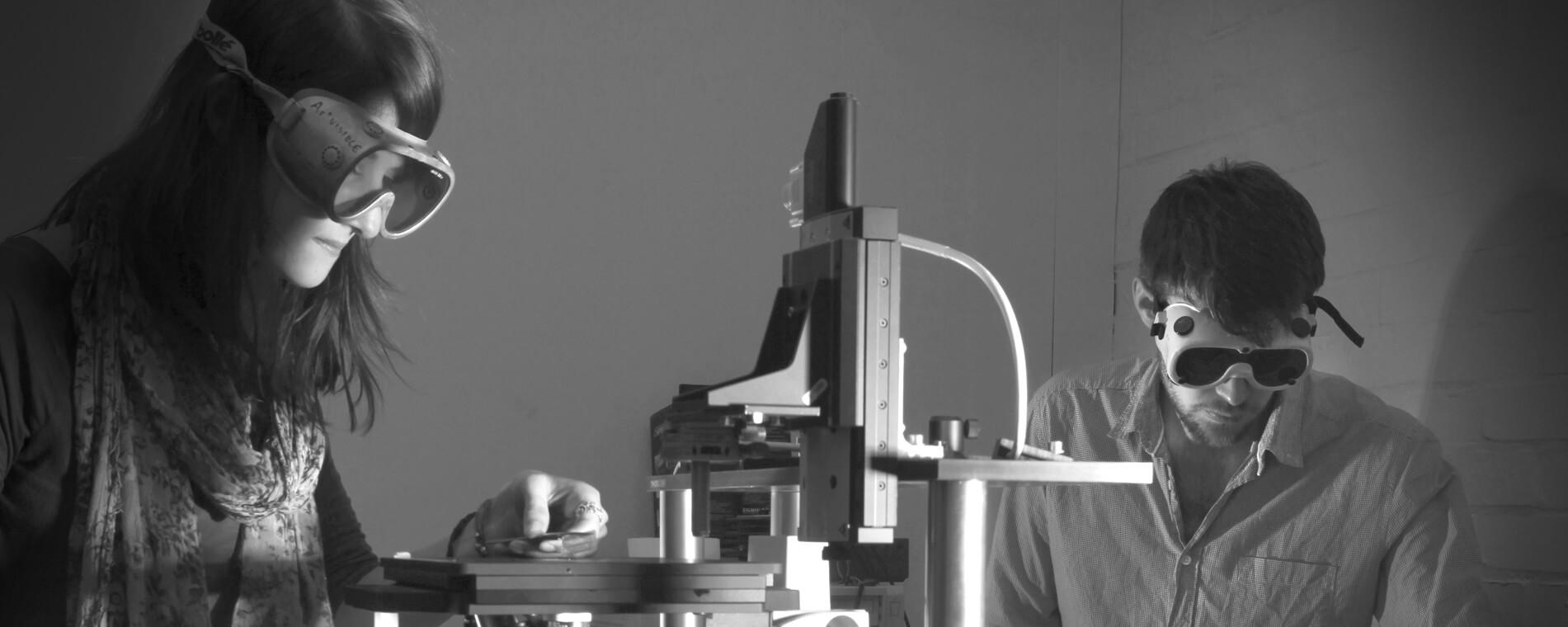 physics students using microscopes