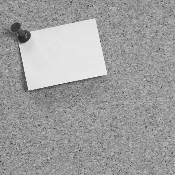 a jobs notice board with an empty note on it
