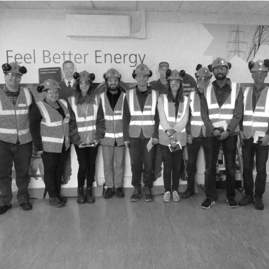 students with high visibility vests on a placement at an energy company