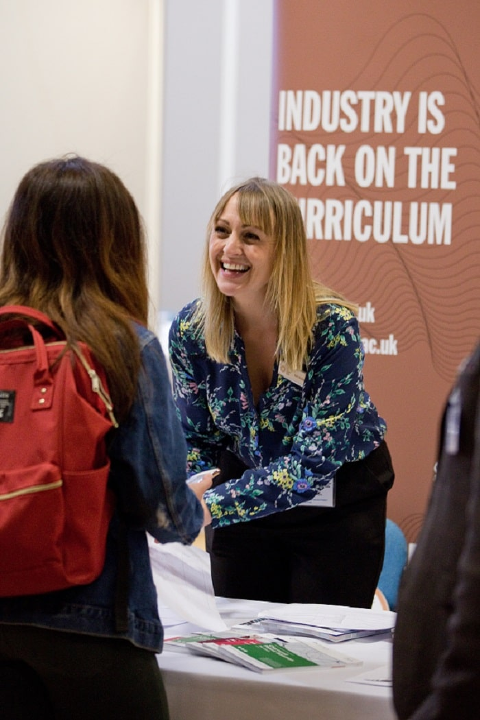 A student getting advice at the WRIPA careers fair