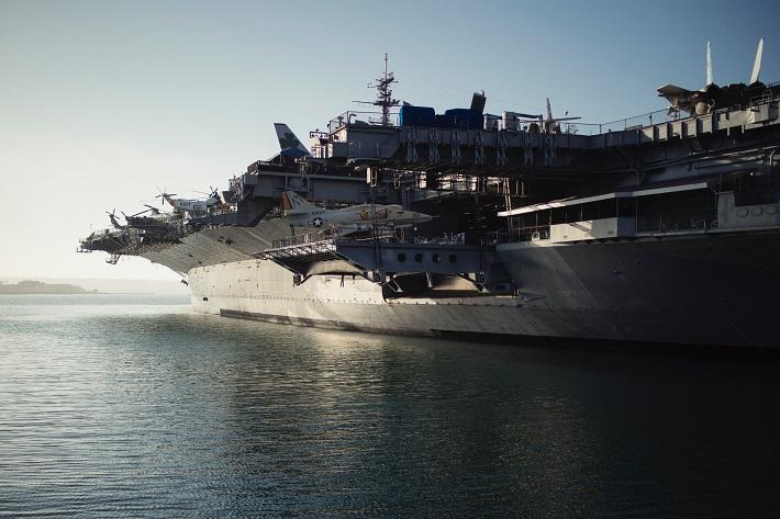 a navy aircraft carrier at sea