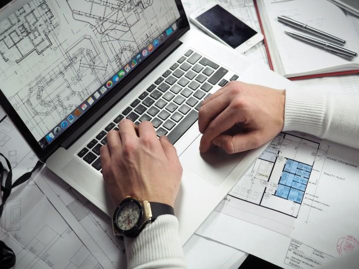 image of a man writing a description of a technical diagram